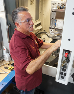 A machinist working on CNC Machining a part